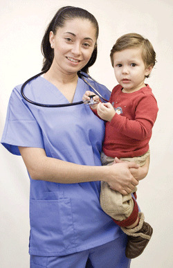 nurse holding a child