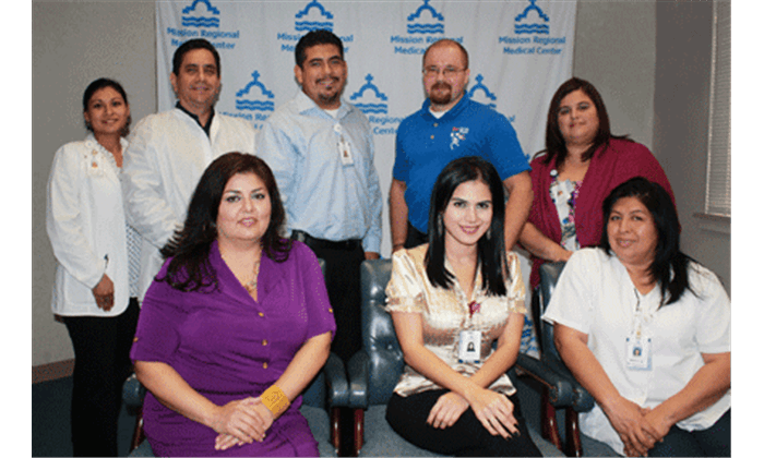 Vivian Vargas, Vice President of Event Management (Mission Chamber); Evelyn Sáenz, Marketing Coordinator (MRMC); and Maria Rios, Registered Nurse (MRMC). Back, L-R: Maria Ester Rodriguez, Project Manager (MRMC); Isauro Resendez, Assistant Director of Laboratory Services (MRMC); Robert Bravo, Clinical Nutrition Manager (MRMC); Matt Ruszczak, Program Director (Mission Chamber); and Lilliam Santana-Barrera, Director of Volunteer Services (MRMC)