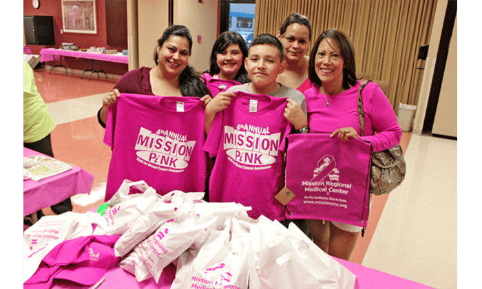 Participants picking up their pink shirts