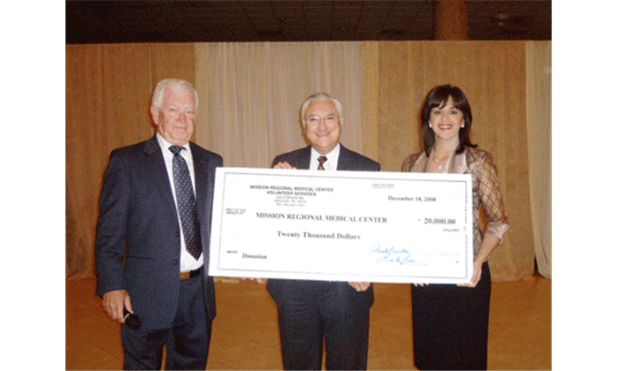 3 people holding large check