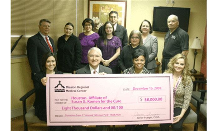 people presenting large pink check